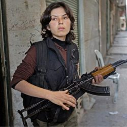 Kurdish Woman beating the hell out of ISIS - The revolution in Rojava